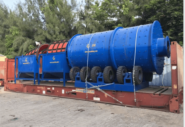 Rotary scrubber load into FR Container